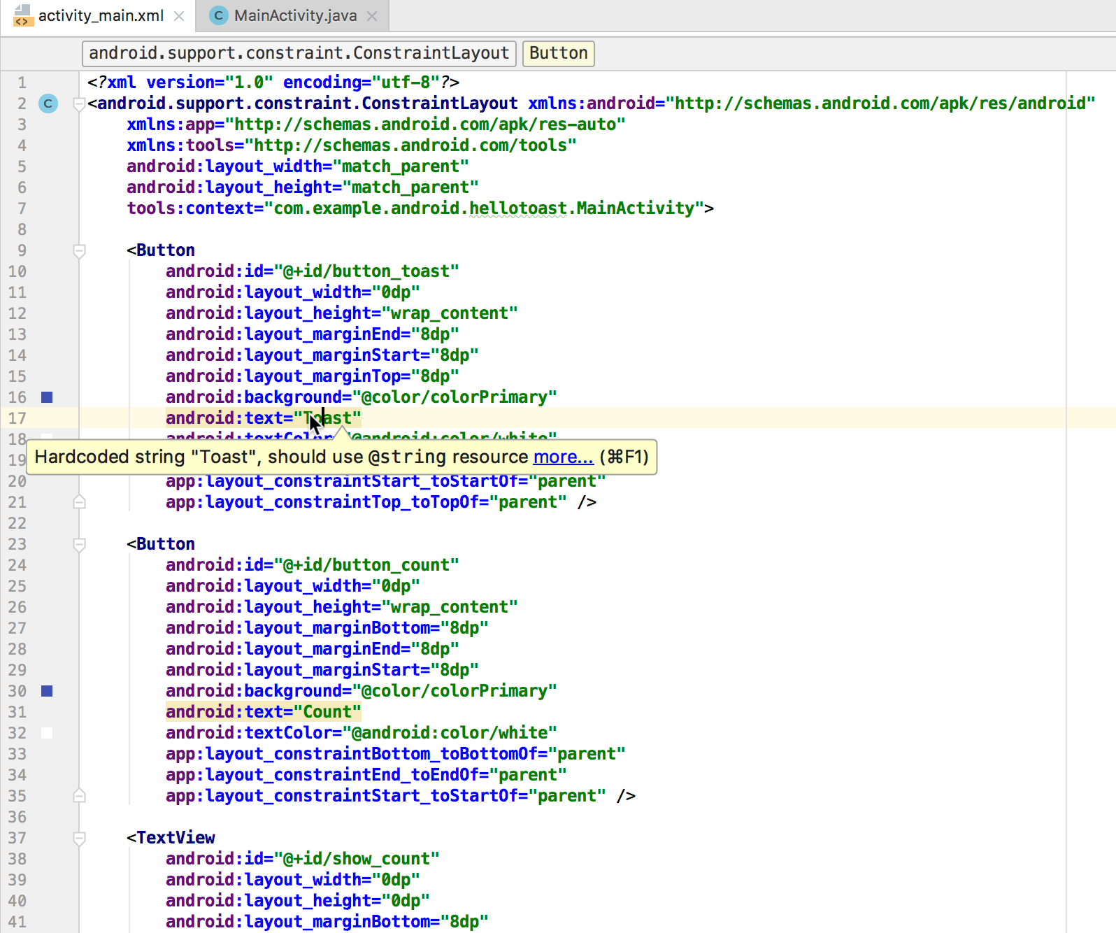 The XML code for the Hello Toast layout showing the first warning